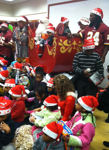 DeJon Gomes looks on as countless children gaze at their new gifts. (Credit: Kimberly Suiters/All-News 99.1 WNEW)