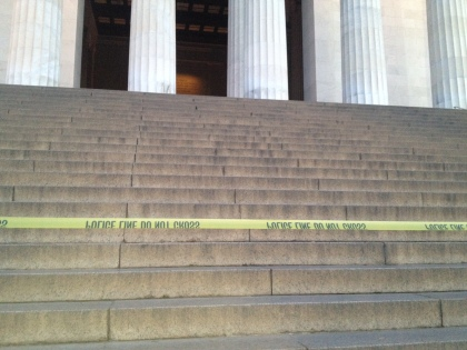 Police tape blocks steps at the base of the Lincoln Memorial after it was vandalized with green paint. (credit: John Domen/All-News 99.1 WNEW)