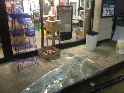 The smashed front of an Exxon station where a truck crashed through the front and robbers stole an entire ATM. (credit: John Domen/All-News 99.1 WNEW)