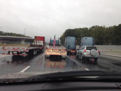 A trucker convoy traveling 10 mph blocks all lanes of traffic on the Capital Beltway. (credit: John Domen/All-News 99.1 WNEW)