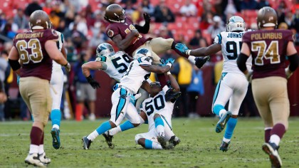 Robert Griffin III is tackled by Luke Kuechly, Captain Munnerlyn, and James Anderson of the Carolina Panthers during the fourth quarter of the Panthers 21-13 win at FedExField on November 4, 2012. (credit: Rob Carr/Getty Images)