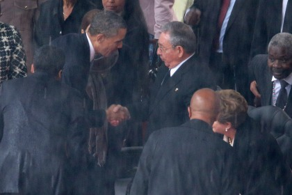 President Barack Obama shakes hands with Cuban President Raul Castro during the memorial service for former South African President Nelson Mandela at FNB Stadium  on Dec. 10, 2013 in Johannesburg, South Africa. (credit: Chip Somodevilla/Getty Images)