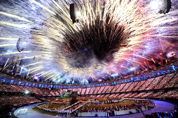 LONDON, ENGLAND - JULY 27:  General view as fireworks illuminate the sky during the Opening Ceremony of the London 2012 Olympic Games at the Olympic Stadium on July 27, 2012 in London, England.