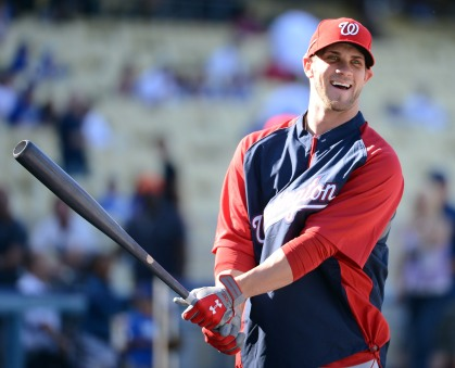 Bryce Harper #34 of the Washington Nationals smiles as he makes his major league debut during practice before the game against the Los Angeles Dodgers at Dodger Stadium on April 28, 2012 in Los Angeles, California. (Credit: Harry How/Getty Images)