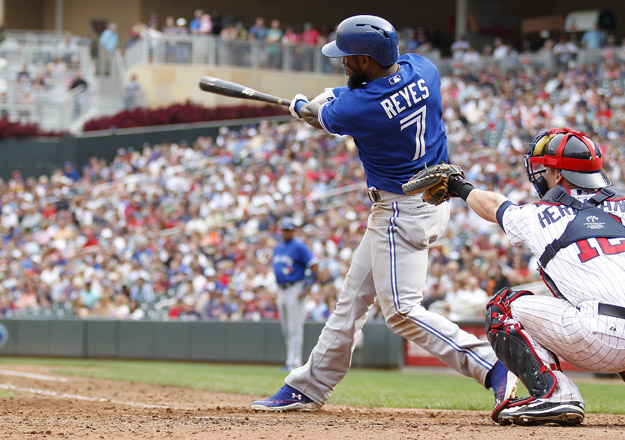 MINNEAPOLIS, MN - SEPTEMBER 8:  Jose Reyes #7 of the Toronto Blue Jays follows through on an RBI single in the 8th inning against the Minnesota Twins during their baseball game on September 8, 2013 at Target Field in Minneapolis, Minnesota.