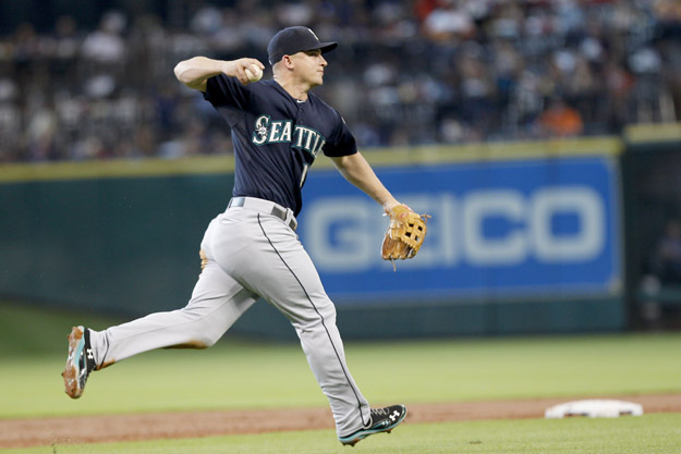 HOUSTON, TX- AUGUST 31: Kyle Seager #15 of the Seattle Mariners fields the ball against the Houston Astros in the first inning on August 31, 2013 at Minute Maid Park in Houston, Texas.