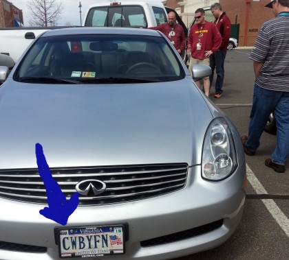 """""""""""Redskins personnel just crushed the back of this car. Look at license plate!"""" (Credit: @JonathanBunn)"""