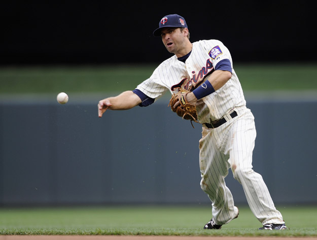 MINNEAPOLIS, MN - JUNE 7: Brian Dozier #2 of the Minnesota Twins throws to first base to get out Jose Altuve #27 of the Houston Astros during the fifth inning of the game on June 7, 2014 at Target Field in Minneapolis, Minnesota. The Twins defeated the Astros 8-0.