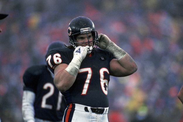 CHICAGO - DECEMBER 30:  Steve McMichael #76 of the Chicago Bears removes his helmet during the game against the Kansas City Chiefs on December 30, 1990 in Chicago, Illinois. The Chiefs won 21-10.