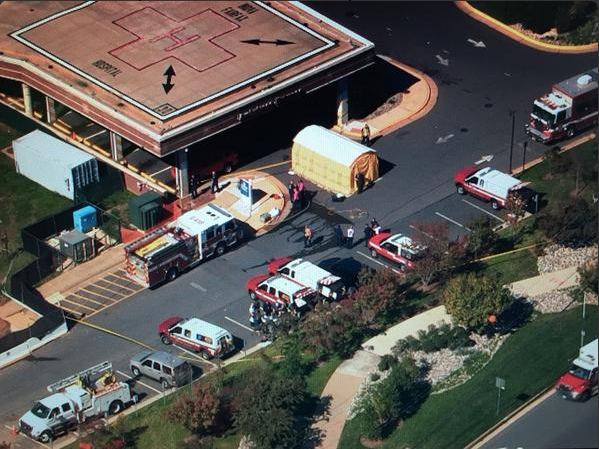 A woman who recently traveled to Africa vomited in the Pentagon parking lot while on a tour and has been transported to Inova Fairfax Hospita. (Photo credit: WNEW reporter Brad Freitas)