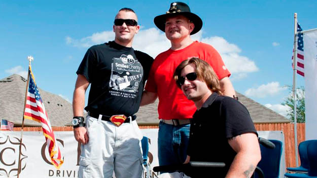Brian Aft poses for a photo with fellow wounded warrior and home recipient, Brandon Byers (left) and Raytheon Missile Systems employee and North Texas RAYVETS president James Bishop (middle). Photo Credit: Conner Howell