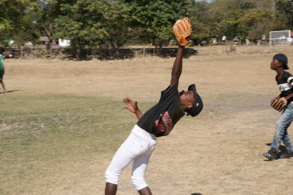 This guy here is literally named 'Gift' and he has great hand eye coordination. We are very proud of this young man's talent and his passion. Last week when we took the field he had somehow found baseball pants and cleats the day before at the local market. (Caption by Chris McCurdy)