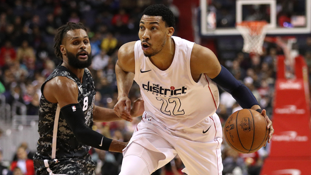 Otto Porter Jr. #22 of the Washington Wizards dribbles past Patty Mills #8 of the San Antonio Spurs during the first half at Capital One Arena on March 27, 2018 in Washington, DC.